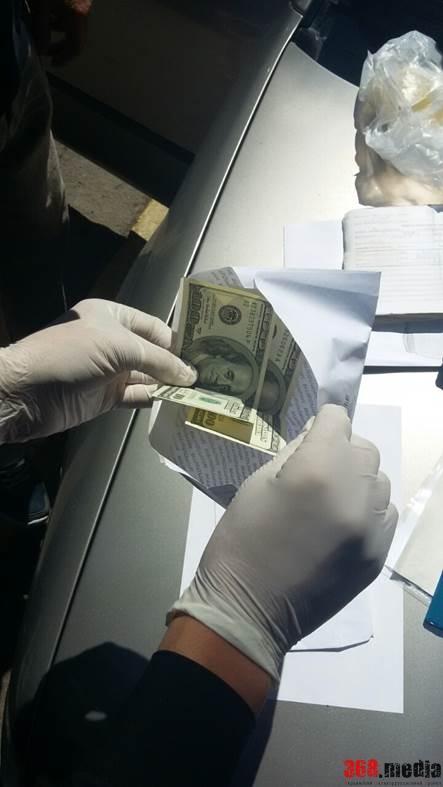 взятка доллар