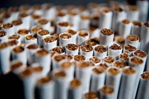 Менеджер табачного монополиста избежал тюрьмы после выплаты 58 млн гривен